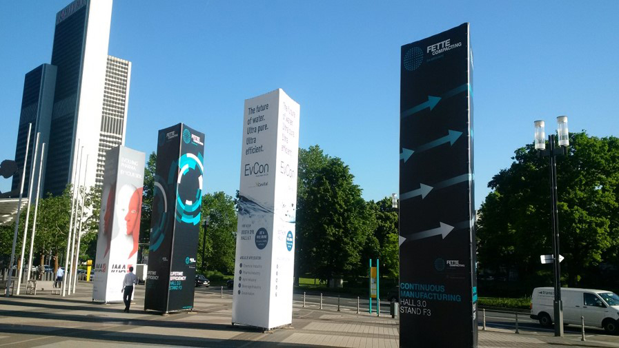 Oktavo advertising towers at the entrance of Messe Frankfurt
