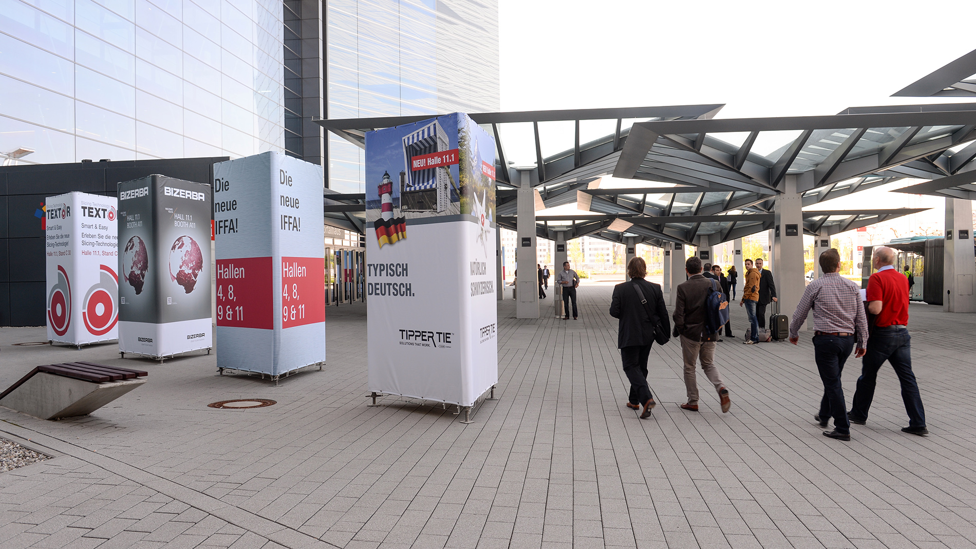 Advertising on the outside of Messe Frankfurt: advertising towers in front of the entrance